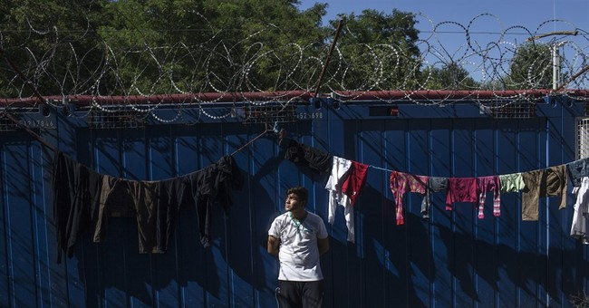 The Latest: 4 dead, 6 rescued off Greek island of Lesbos