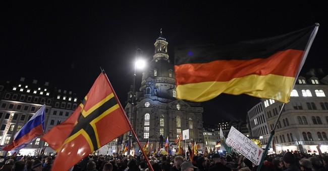 Survey: Europeans worry migrants may increase terror threat