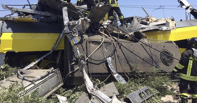 The Latest:  Italy train crash death toll 22, official says