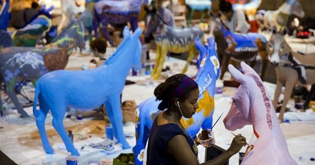 Fracking foes put fake feces under donkey art displays