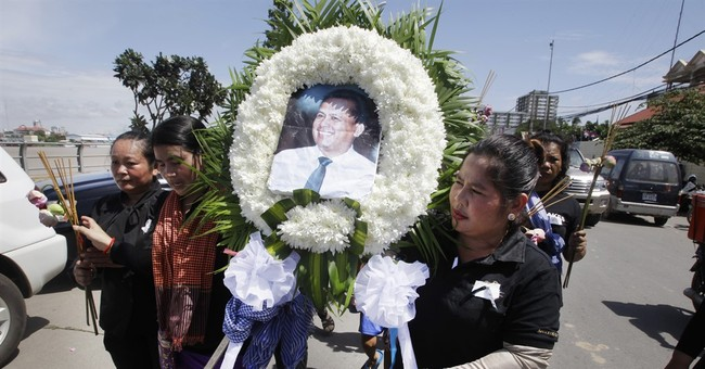 Wife of alleged Cambodian killer 'shocked' by accusations