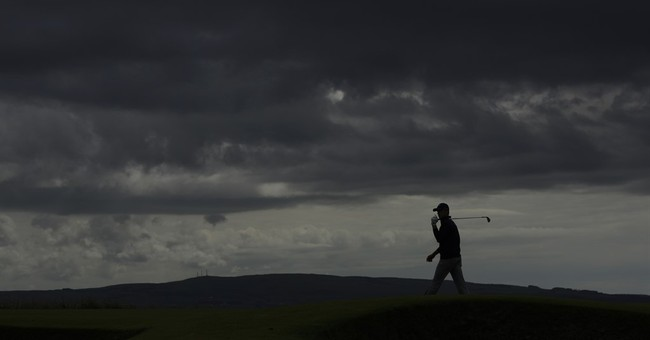 The Latest: British Open caddie struck by ball, hospitalized