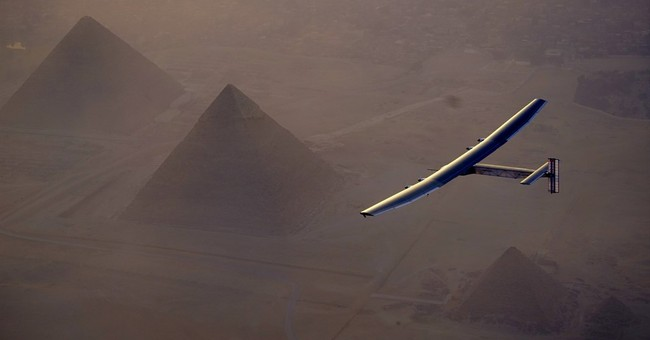 Solar plane flies over Egypt pyramids on globe-circling trip