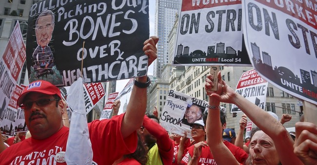 The Latest: Striking Taj workers question health care offer