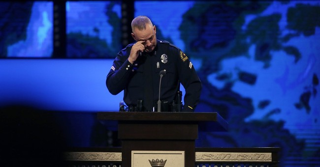 The Latest: Dallas shooter a loner, collected guns, knives
