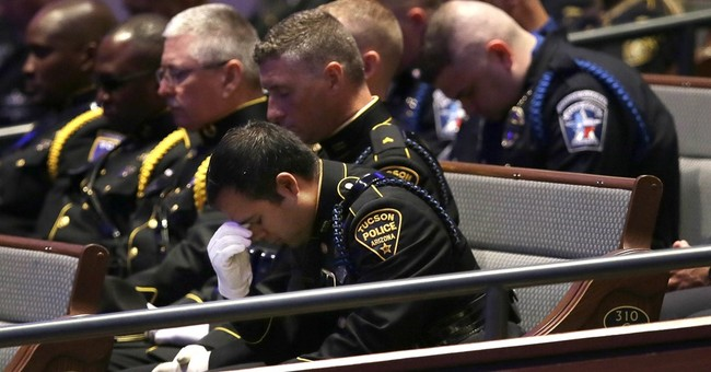 Thousands gather to mourn, honor 3 slain officers in Dallas