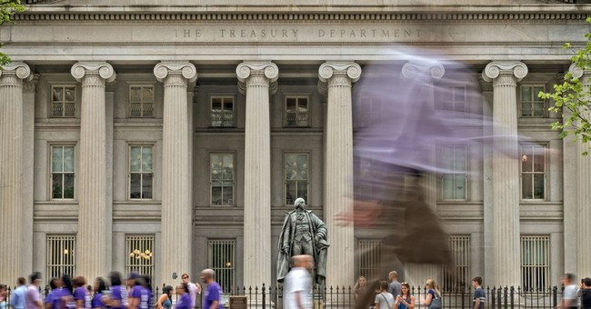 US sees small surplus in June, but deficit up for year