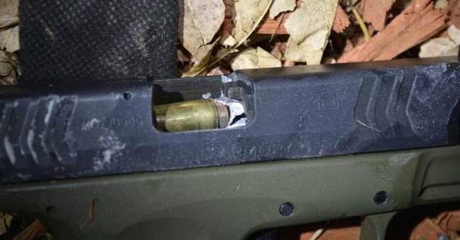 "Deputy fires ""1 in a billion"" shot into suspect's gun barrel"