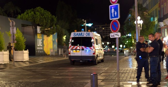 Truck slams into revelers in Nice, at least 80 dead
