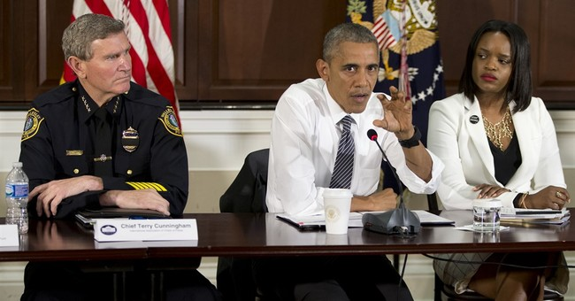 At town hall, Obama confronts race issues bigger than police