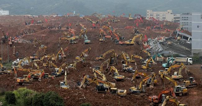 China holds 53 people in investigation of deadly landslide