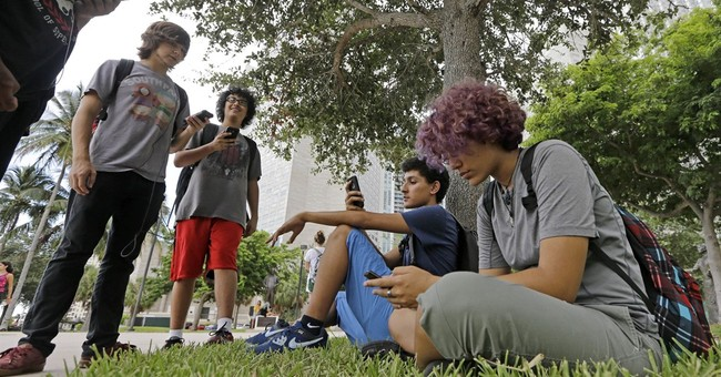 The Latest: Celebrities among the fans searching for Pokemon