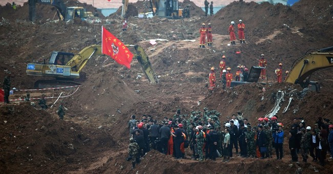 China holds 53 people in investigation of deadly landslide