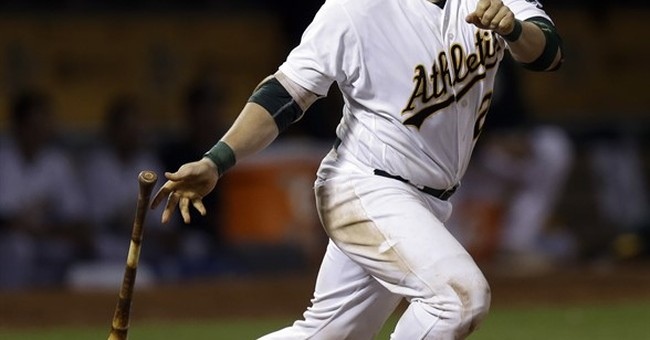 A's beat Blue Jays 8-7 with help of instant replay