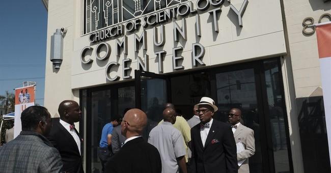 The Latest: Big crowd attends rapper's anti-violence summit