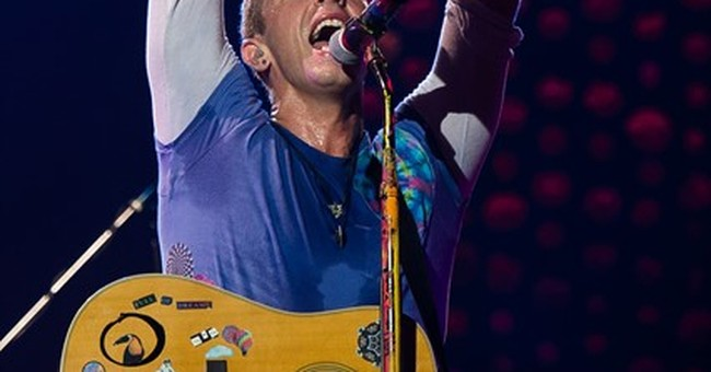 Coldplay kicks off stadium tour with colorful show