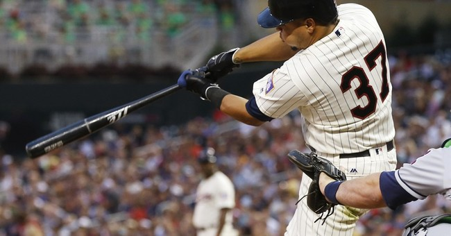 Mauer scores on error by Gomes in 11th to give Twins 5-4 win