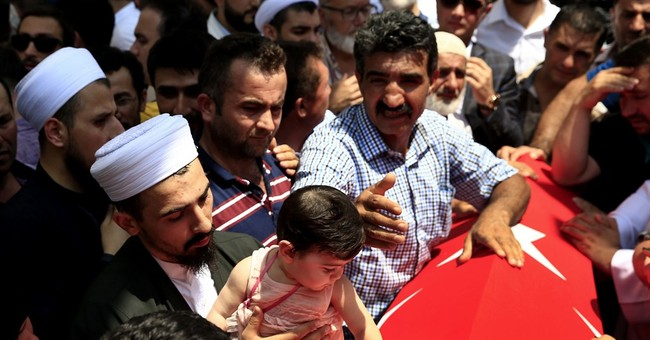 AP PHOTOS: Relatives mourn victims of Turkey's failed coup