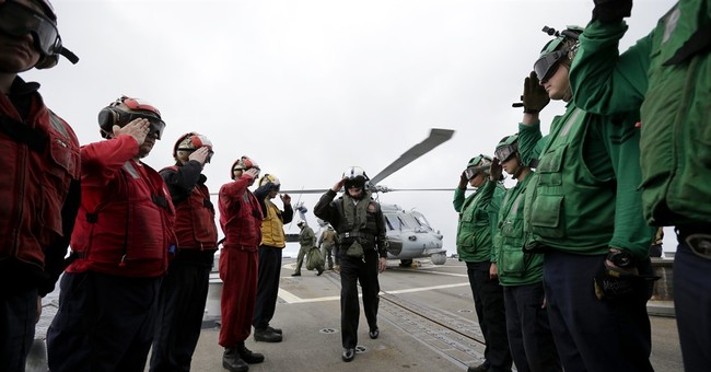 Navy carrier group powered partly by biofuel sets sail