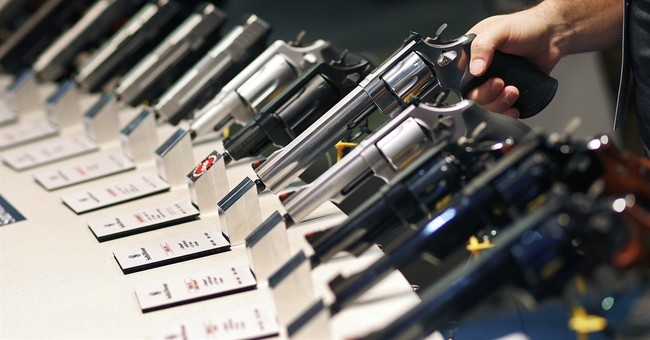 Regulatory moves don't dampen big gun industry show in Vegas