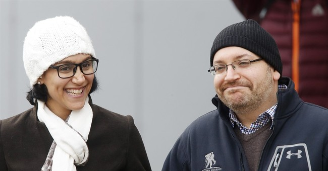 Post's Rezaian makes brief appearance outside hospital