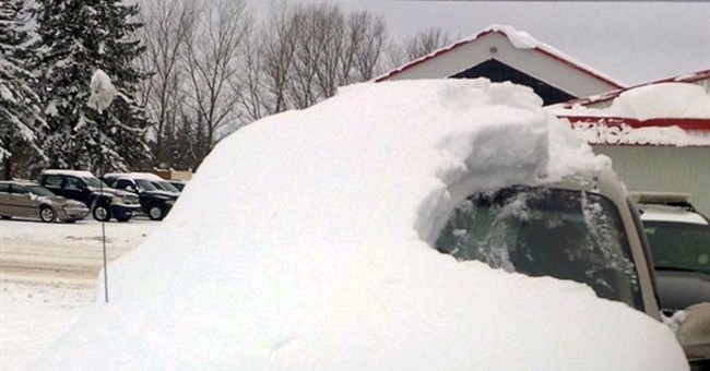 Man charged after his car almost completely covered in snow
