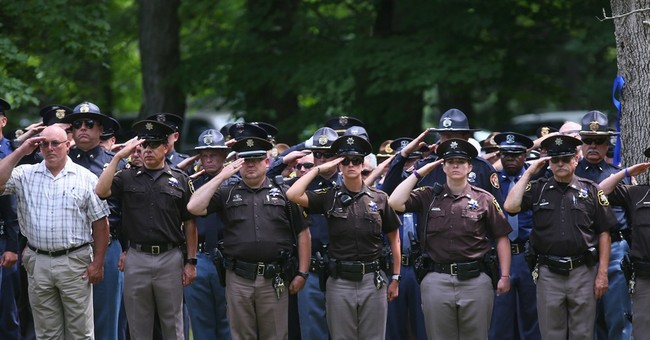 Funeral for Michigan bailiff killed at court draws hundreds