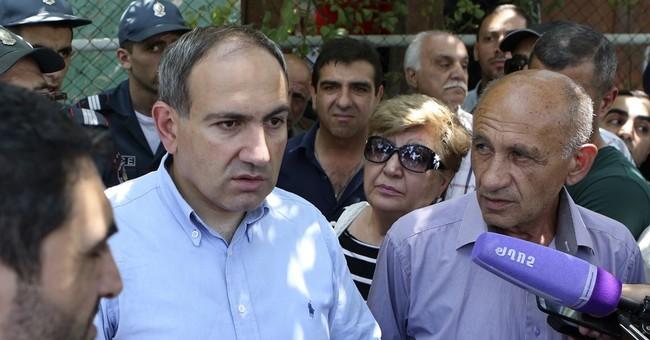 5 Armenian policemen still held hostage a day after attack