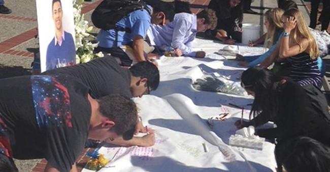 The Latest: Vigil honors Berkeley student slain in France