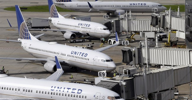 United 2Q profit falls 51 percent, revenue down too