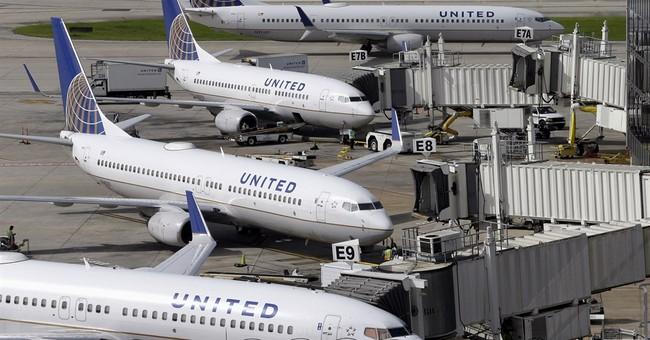 United 2Q profit falls 51 percent, revenue down too