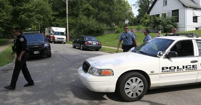 The Latest: Slain Kansas officer's partner is expecting
