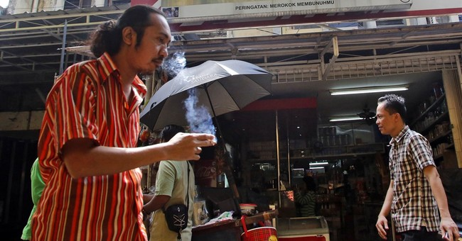 Philip Morris Int'l 2Q results miss Street, boosts outlook