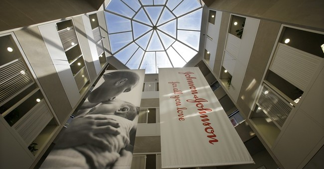 Johnson & Johnson tops 2Q forecasts despite profit drop