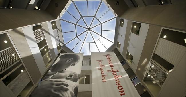 Johnson & Johnson tops 2Q forecasts despite profit drop