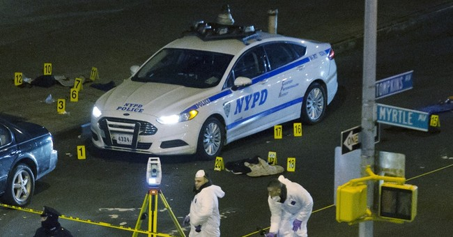 A look at police ambush killings in US and its territories