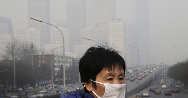 Beijing says air quality improved in first half of 2016