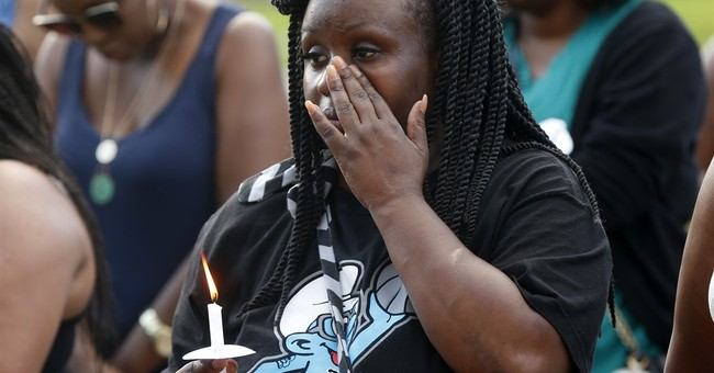 Friends recall slain officers as residents gather to mourn