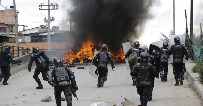 Striking truckers clash with police in Colombia's capital