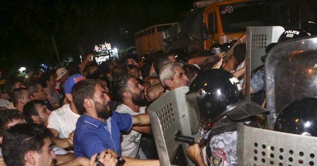 Demonstrators, Armenia police clash outside station