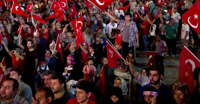 The Latest: Erdogan declares 3-month state of emergency