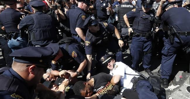 17 arrested in flag-burning melee outside GOP convention