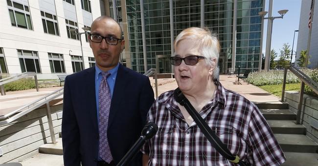 The Latest: Judge urges settlement in gender passport case