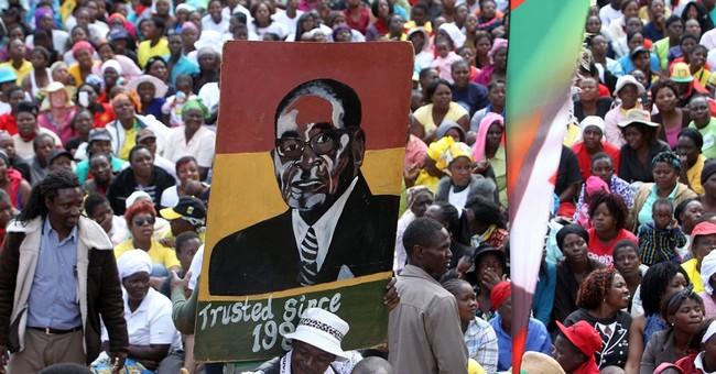 Zimbabwe leader's loyalists make surprise break with Mugabe