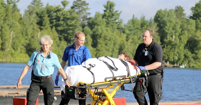 Scout leader: Storms kill boy, woman in northern Minnesota