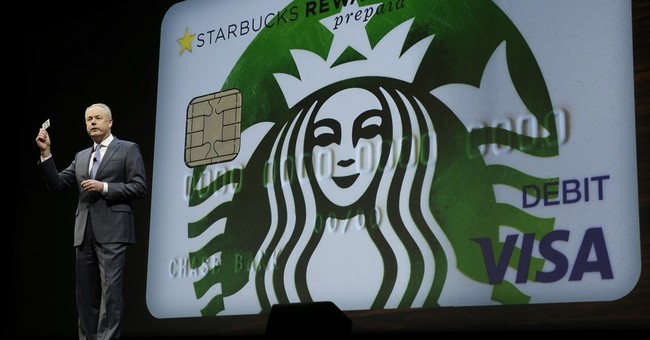 Starbucks cuts sales forecast after growth slows