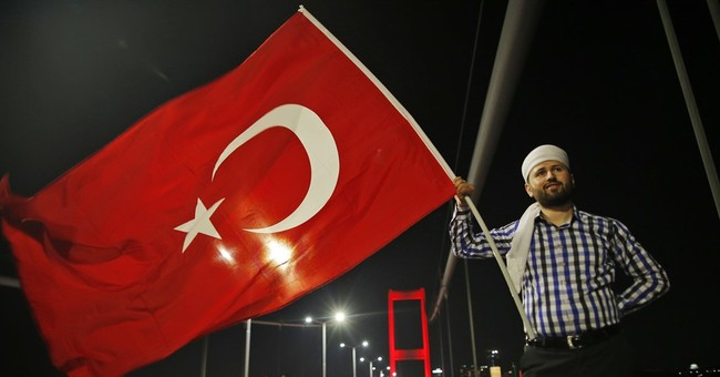 The Latest: Thousands on Istanbul bridge protest coup try