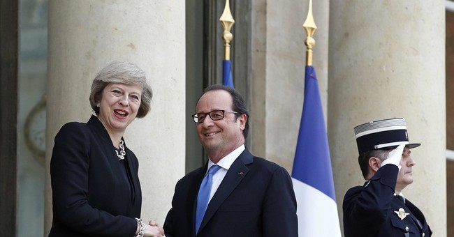 UK PM May reassures France on defense ties after EU exit