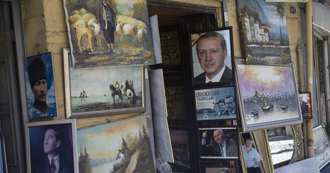 Turkish lawmakers give leader Erdogan sweeping new powers