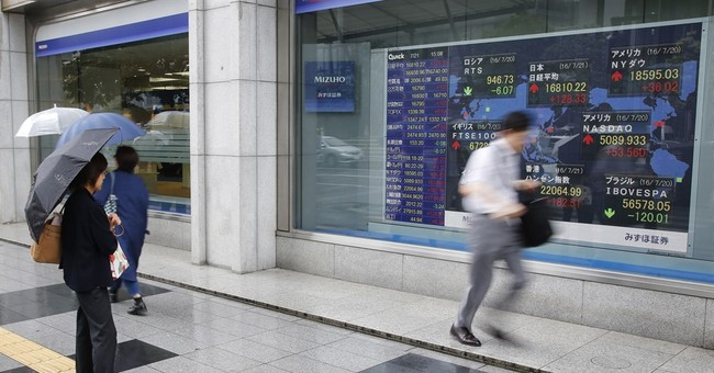 Asian shares down as central banks wait and see
